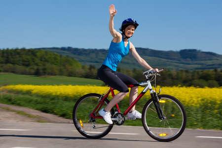 one lane street sign: Woman cycling