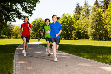 family exercise: Active family - mother and kids running outdoor