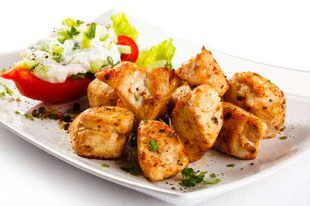 shashlik: Grilled meat and vegetables on white background