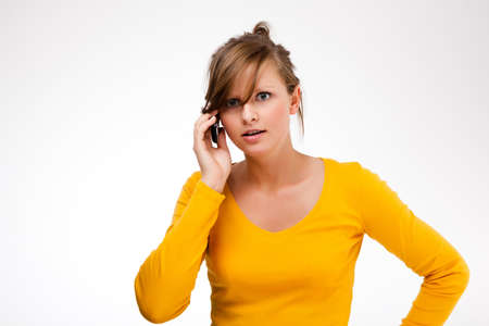 Young woman using mobile phone on white background Stock Photo - 16883165