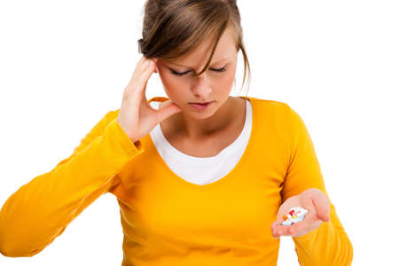 Suffering woman holding pills isolated on white background photo