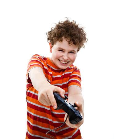ni�os jugando videojuegos: Boy con controlador de video juego Foto de archivo
