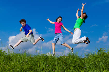 hopping:  Active family - mother and kids running, jumping outdoor