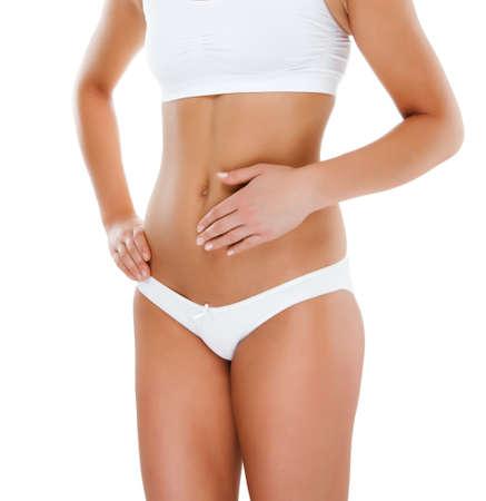 abdomen plano: Mujer masajear dolor de estómago aislado en blanco