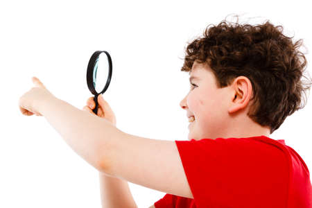Boy looking through magnifying glass isolated on white Stock Photo - 17103166
