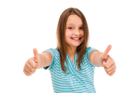 8 9 years: Girl showing OK sign isolated on white background