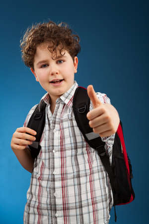 Boy showing OK sign photo