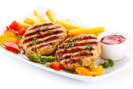 Grilled steaks, French fries and vegetables Stock Photo - 17226359