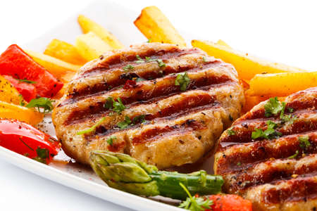 pork chop: Grilled steaks, French fries and vegetables