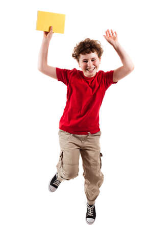 Boy jumping, running isolated on white background photo