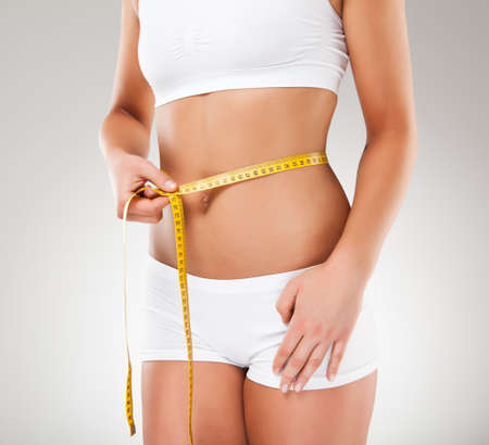 Woman measuring her slim body Stock Photo