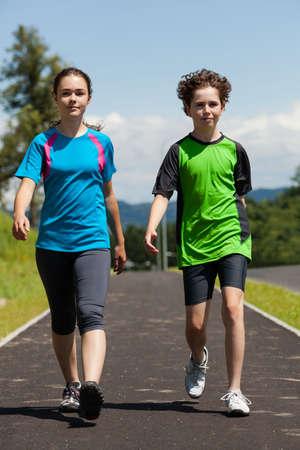 Girl and boy running, walking outdoor Stock Photo - 17347178