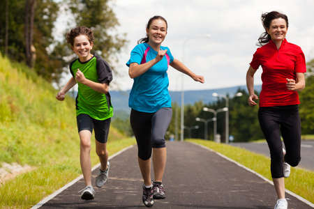 hopping: Active family - mother and kids running outdoor
