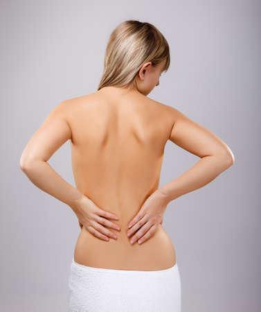 woman back pain: Woman massaging pain back Stock Photo