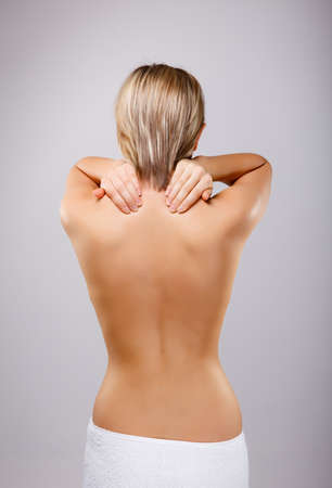 Woman massaging pain back photo