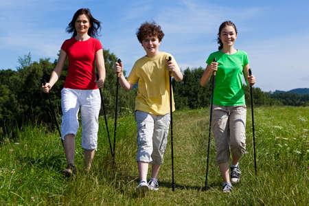 Nordic walking - active family walking outdoor photo