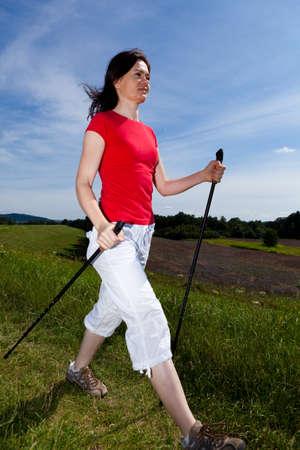 power walking: Nordic walking - active woman outdoor