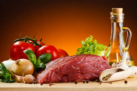 beef meat: Raw beef on cutting board and vegetables
