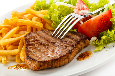 sirloin steak: Grilled steak, French fries and vegetables Stock Photo
