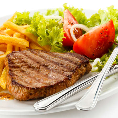 steak plate: Grilled steak, French fries and vegetables Stock Photo