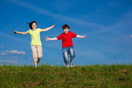 Girl and boy running, jumping outdoor Stock Photo - 17567196