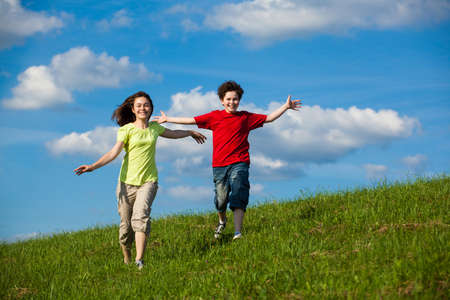 Girl and boy running, jumping outdoor Stock Photo - 17567193