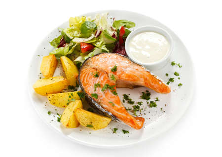 Grilled salmon, baked potatoes and vegetables Stock Photo - 17756550