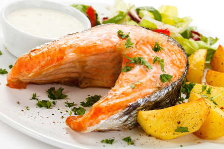Grilled salmon, baked potatoes and vegetables Stock Photo - 17756567