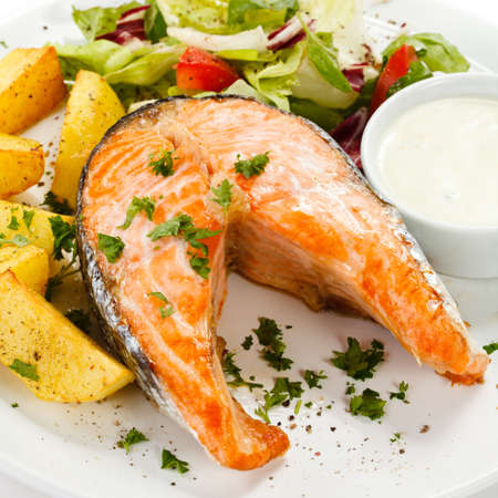 Grilled salmon, baked potatoes and vegetables Stock Photo - 17756559