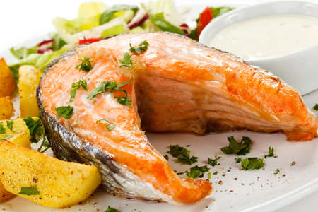 fried fish: Grilled salmon, baked potatoes and vegetables Stock Photo