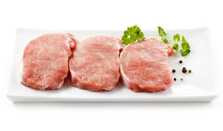 loin: Fresh raw pork on white plate Stock Photo