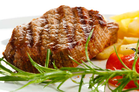loin: Grilled steaks, French fries and vegetables