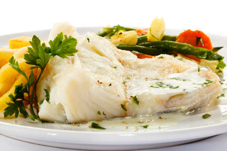 fish sauce: Fish dish - fish fillet, French fries and vegetables Stock Photo