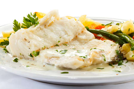 potato cod: Fish dish - fish fillet, French fries and vegetables Stock Photo