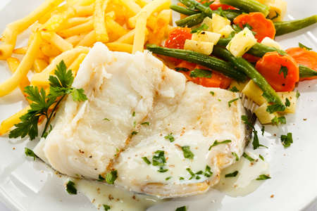 cod fish: Fish dish - fish fillet, French fries and vegetables Stock Photo