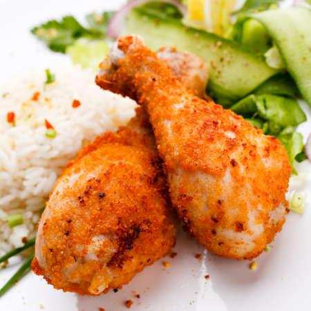 drumsticks: Roasted chicken drumsticks, rice and vegetables