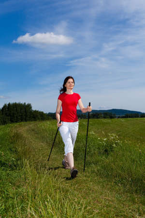 Nordic walking - donna attiva all'aperto photo