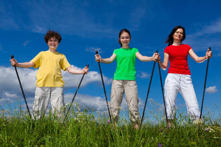 Nordic walking - active family walking outdoor photo