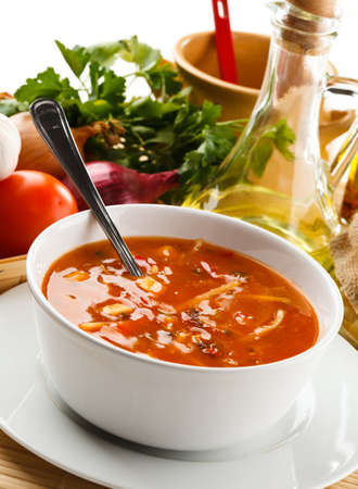 Tomato soup with ingredients photo