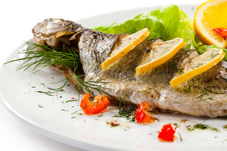 cod fish: Fish dish - roast trout and vegetables Stock Photo