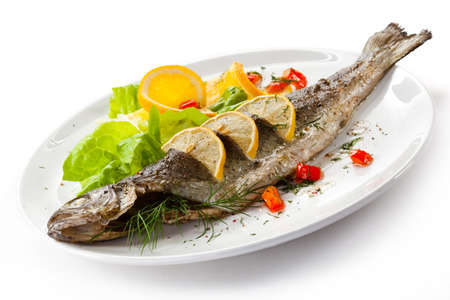 Fish dish - roast trout and vegetables Imagens