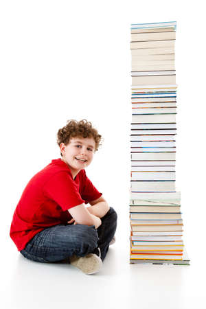 Student sitting close to pile of books on white background photo
