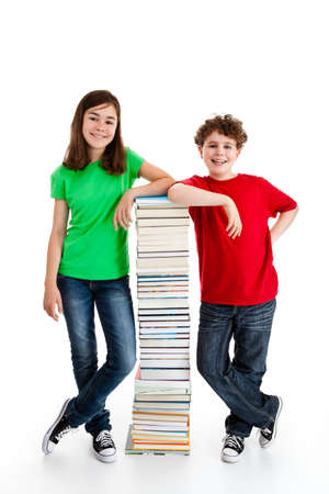 Students standing close to pile of books on white photo