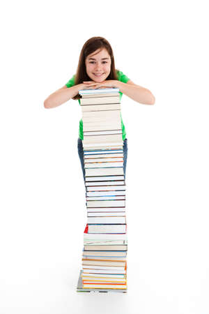 Student standing close to pile of books on white photo