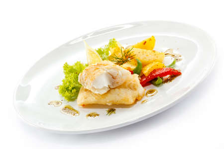 baked potato: Fish dish - fried fish fillets and vegetables
