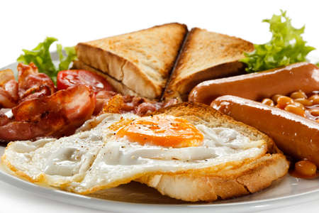 English breakfast - toast, egg, bacon and vegetables photo