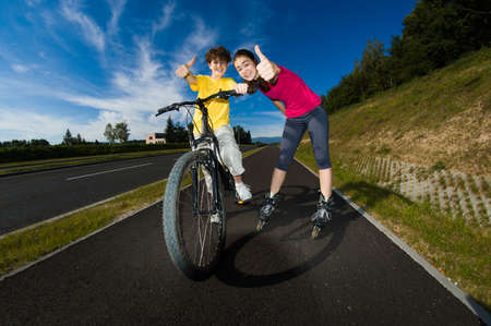 Active young people - rollerblading, cycling photo