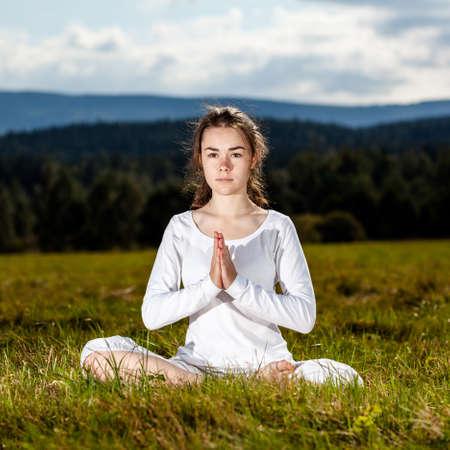 Woman exercising yoga outdoor Stock Photo - 17993499