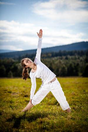poise: Woman exercising yoga outdoor Stock Photo