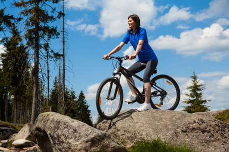 mountain biker: Woman cycling